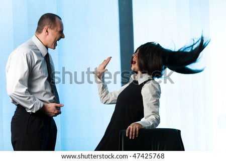 Businessman and women with long hair - stock photo