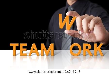 Businessman and word Teamwork - stock photo
