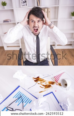 Businessman angry over spilled coffee on documents - stock photo