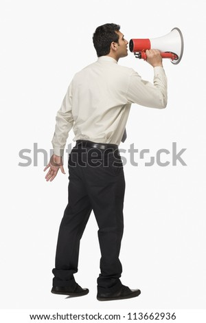 Businessman announcing into a megaphone - stock photo