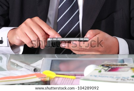Businessman are using smart phone - stock photo