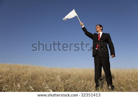 businessman asking for surrendering with a white flag - stock photo