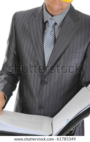 businessman at a construction. Isolated on white background - stock photo