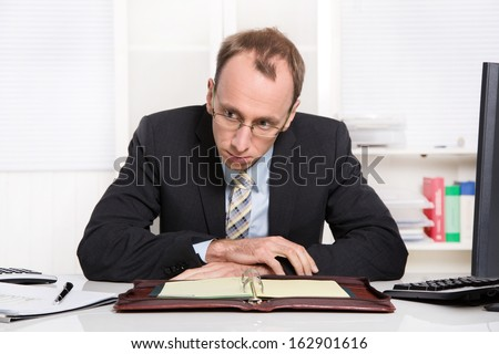 Businessman at desk with problems, stress and overworked sitting in his office - stock photo