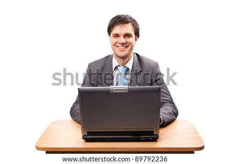 Businessman at his desk with a laptop, isolated on white background - stock photo