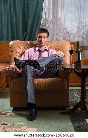 Businessman at home after hard working day