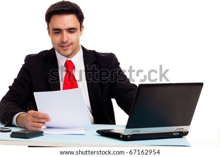 Businessman at the desk working - stock photo