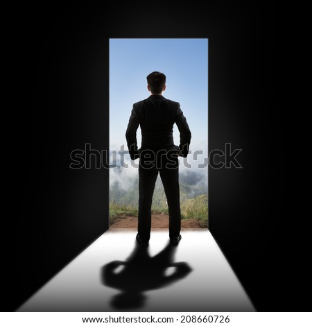 Businessman at the door - stock photo