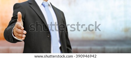 Businessman at the office giving hand shake