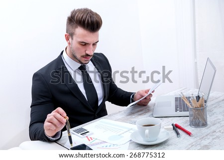 Businessman at the office working on a Business Plan - stock photo