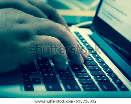 Businessman at work. Close-up of man working on laptop cold vintage