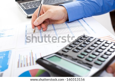 Businessman at work in his office - stock photo