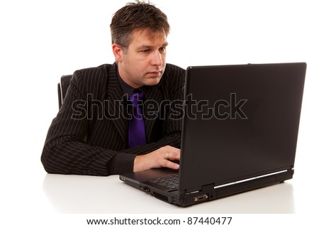 Businessman at work on laptop over white background