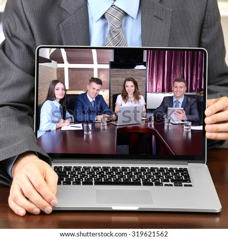 Businessman attending video conference - stock photo