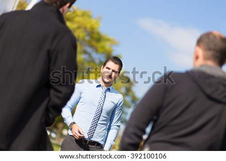 Businessman being approached and blackmailed by two racketeers. - stock photo