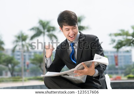 Businessman being excited with the latest news - stock photo