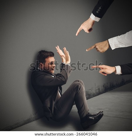 Businessman blamed unfairly by his work colleagues - stock photo