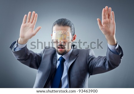 Businessman blinded with money - stock photo