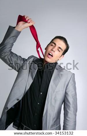 Businessman break finish work upset take off tie - stock photo