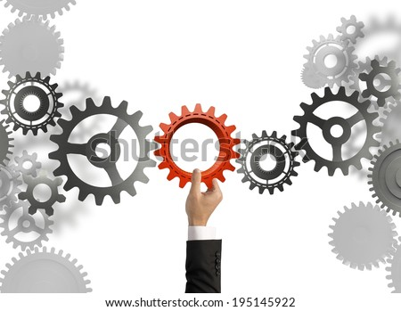 Businessman builds a business system with gear - stock photo