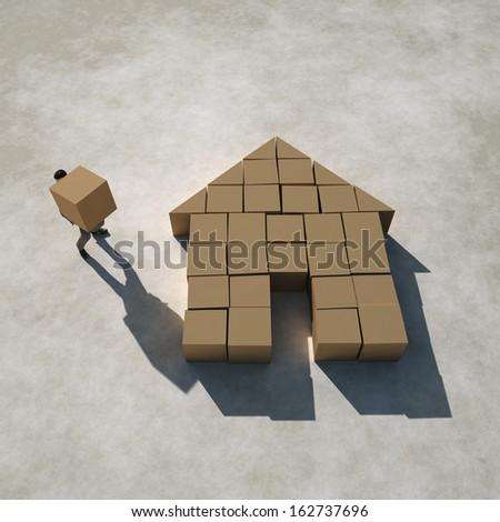 businessman builds a house - stock photo