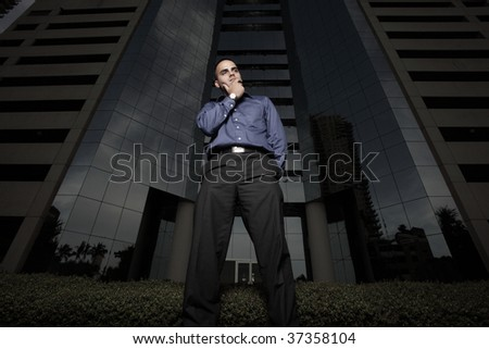 Businessman by a building