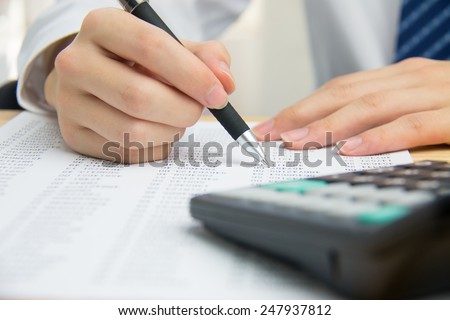 Businessman calculating the financial statements - stock photo