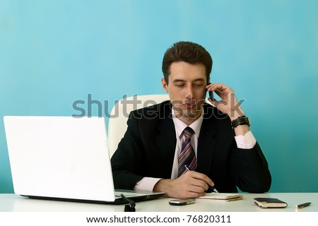 Businessman calls phone in office