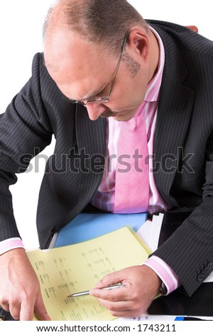 Businessman carefully checking the content of his documents - stock photo