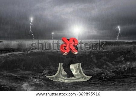 Businessman carrying 3D percentage symbol on money boat in sea with storm - stock photo
