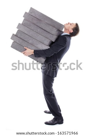 Businessman carrying high burden - stock photo