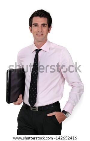 Businessman carrying laptop underarm - stock photo