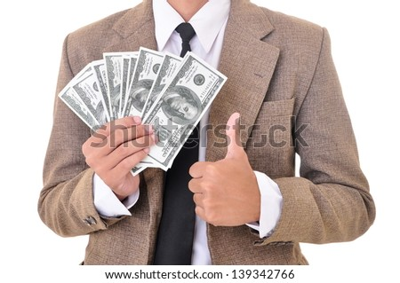 Businessman carrying money and showing thumbs up, isolated on white background - stock photo
