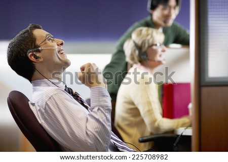 Businessman Celebrating Good News - stock photo