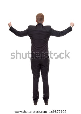 Businessman celebrating with raised arms isolated on white - stock photo