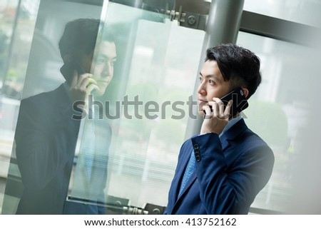 Businessman chat on cellphone phone - stock photo