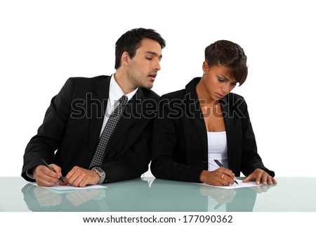 Businessman cheating in exam - stock photo