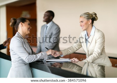 businessman check in at hotel reception - stock photo
