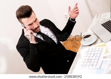 Businessman checking appointments in the calendar at the office  - stock photo