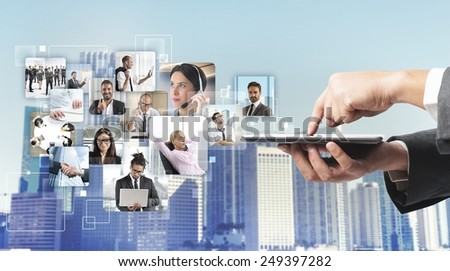 Businessman checking his business team while working - stock photo