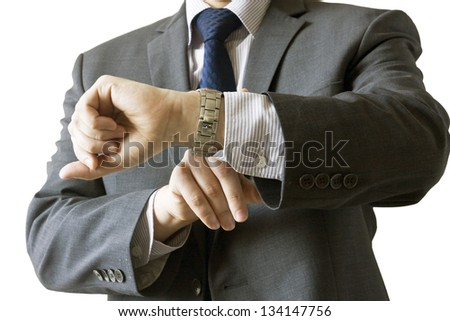 Businessman checking his watch isolated on white background