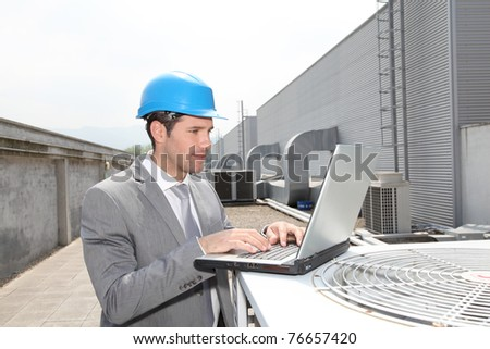 Businessman checking industrial installation