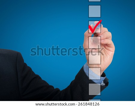 Businessman checking mark checklist marker Isolated on blue background. Stock Photo