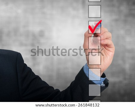 Businessman checking mark checklist marker Isolated on grey background. Stock Photo - stock photo