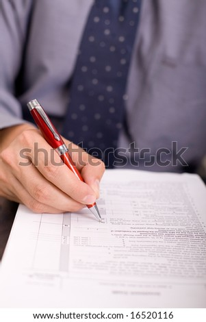 businessman checking or signing contract papers