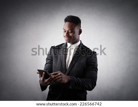 Businessman checking out results with his tablet