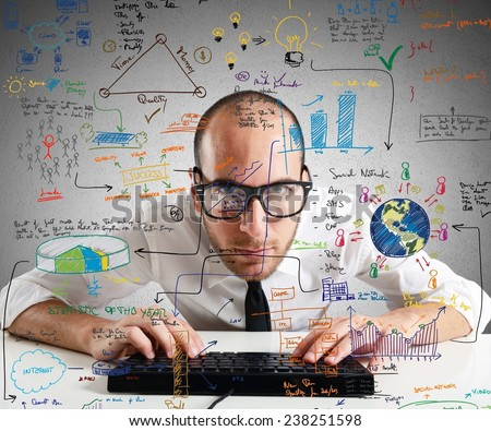 Businessman checking statistics and diagrams on pc