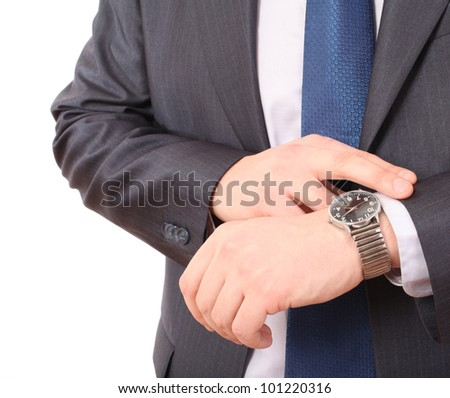 Businessman checking the time on his wristwatch. - stock photo