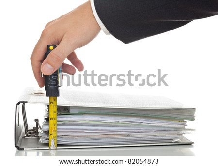 Businessman checks level of performed work - performance or financial analysis concept; focus on the ruler