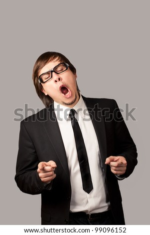 Businessman cheering. Isolated On Gray - stock photo